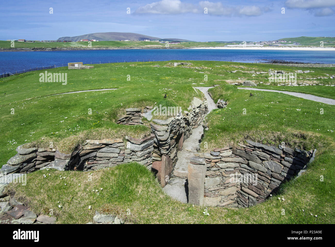Remains of earthhouse at Jarlshof, archaeological site showing prehistoric and Norse settlements at Sumburgh Head, Shetland Islands, Scotland, UK - Stock Image