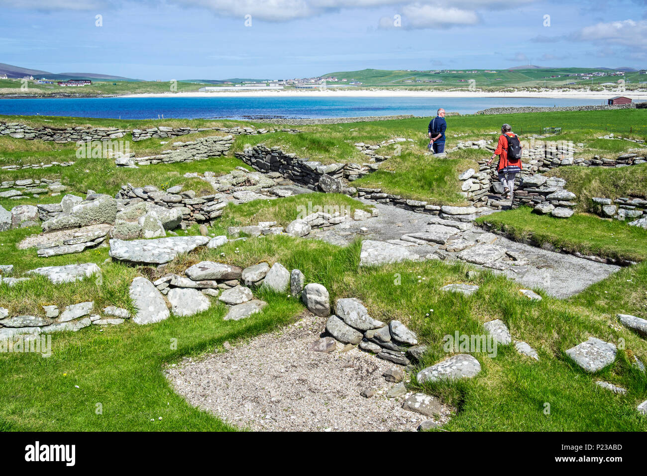 Tourists visiting Jarlshof, archaeological site showing 2500 BC prehistoric and Norse settlements at Sumburgh Head, Shetland Islands, Scotland, UK - Stock Image
