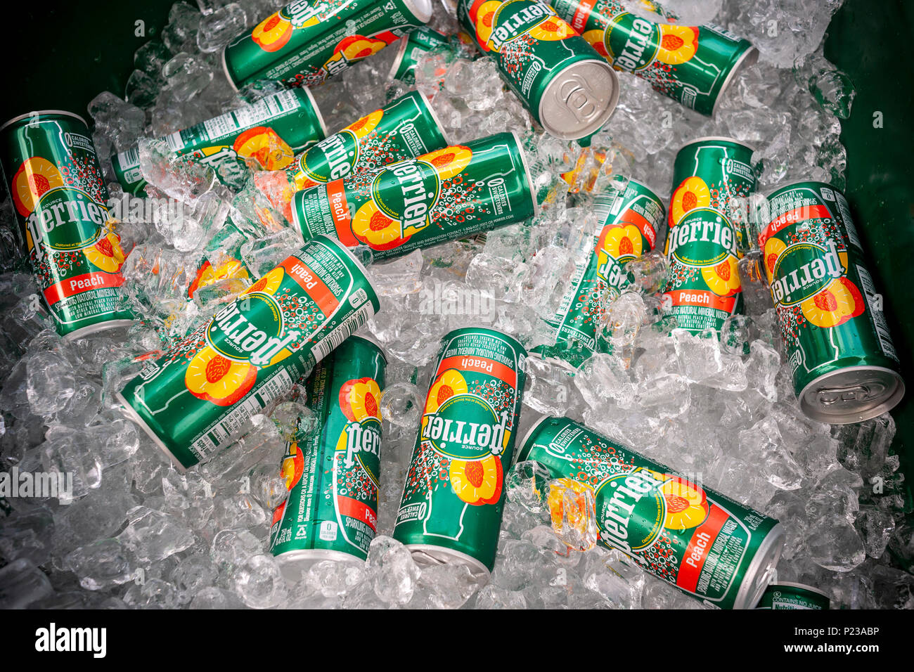 Cans of Perrier juice flavored carbonated water, seen at a street fair in New York on Saturday, June 2, 2018. The new product from Nestlé Waters, Perrier's parent company, addresses the increased popularity of flavored carbonated waters spear-headed by the millennial favorite La Croix. (© Richard B. Levine) - Stock Image