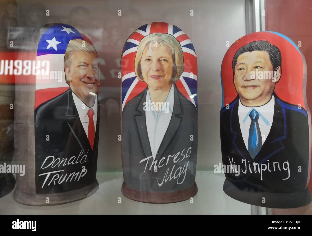 Russian dolls of political figure, US President Donald Trump, Prime Minister Theresa May and Chinese President Xi Jinping in a souvenir shop in the centre of Moscow which quoted a price of 7,000 Russian rubles (£84) for the wooden likeness of the England captain Harry Kane as anticipation builds for the opening of the World Cup. - Stock Image