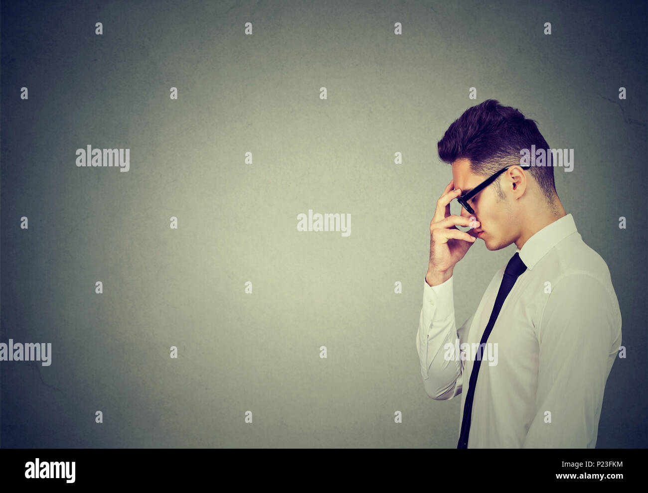 Serious business man thinking very hard - Stock Image