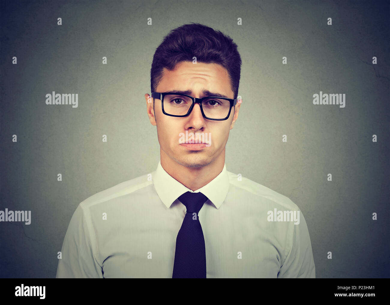 Sad pity looking young business man - Stock Image