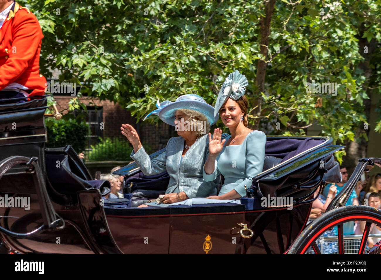 Duchess Of Cambridge,Kate Middleton & Duchess Of Cornwall,Camilla,ride together in a carriage, wave to the crowds at The Trooping Of The Colour 2018 Stock Photo