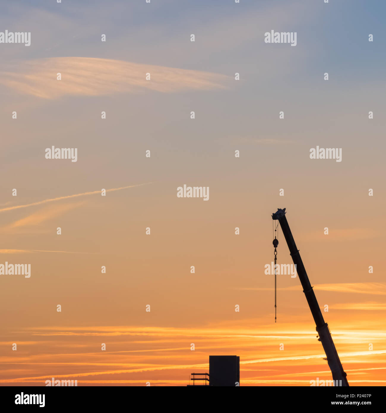 the arm of the crane and a block - Stock Image