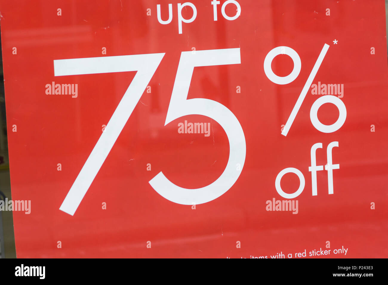 Summer sales sign in Truro (Cornwall) shop window. Metaphor high street squeeze, retail squeeze. Stock Photo