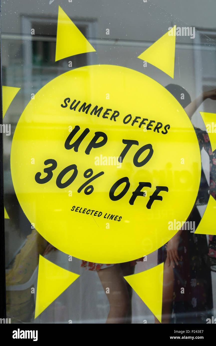 Summer sales sign in Truro (Cornwall) shop window. Metaphor high street squeeze, retail squeeze. - Stock Image