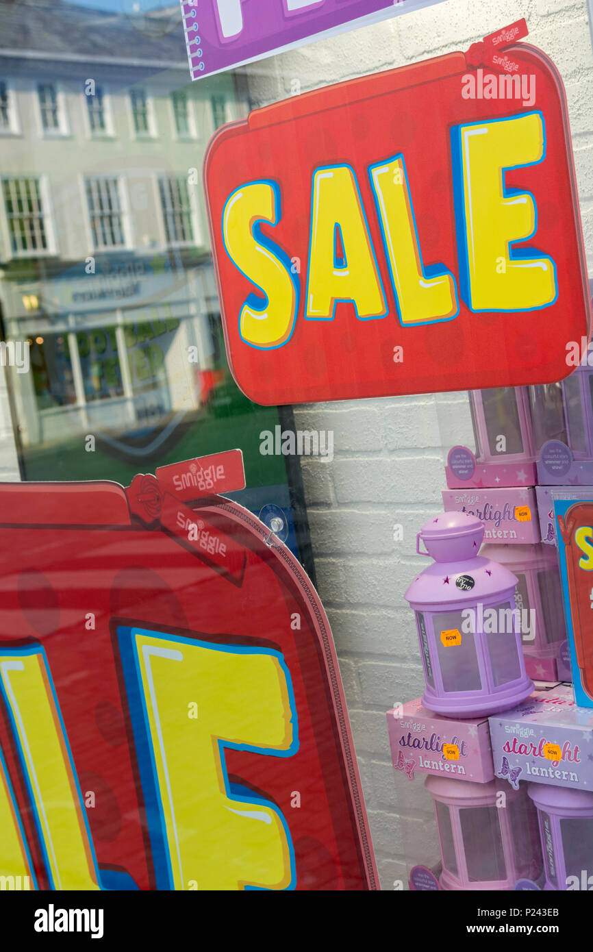 Summer sales sign in Truro (Cornwall) shop window. Metaphor high street squeeze, retail squeeze. - Stock Image