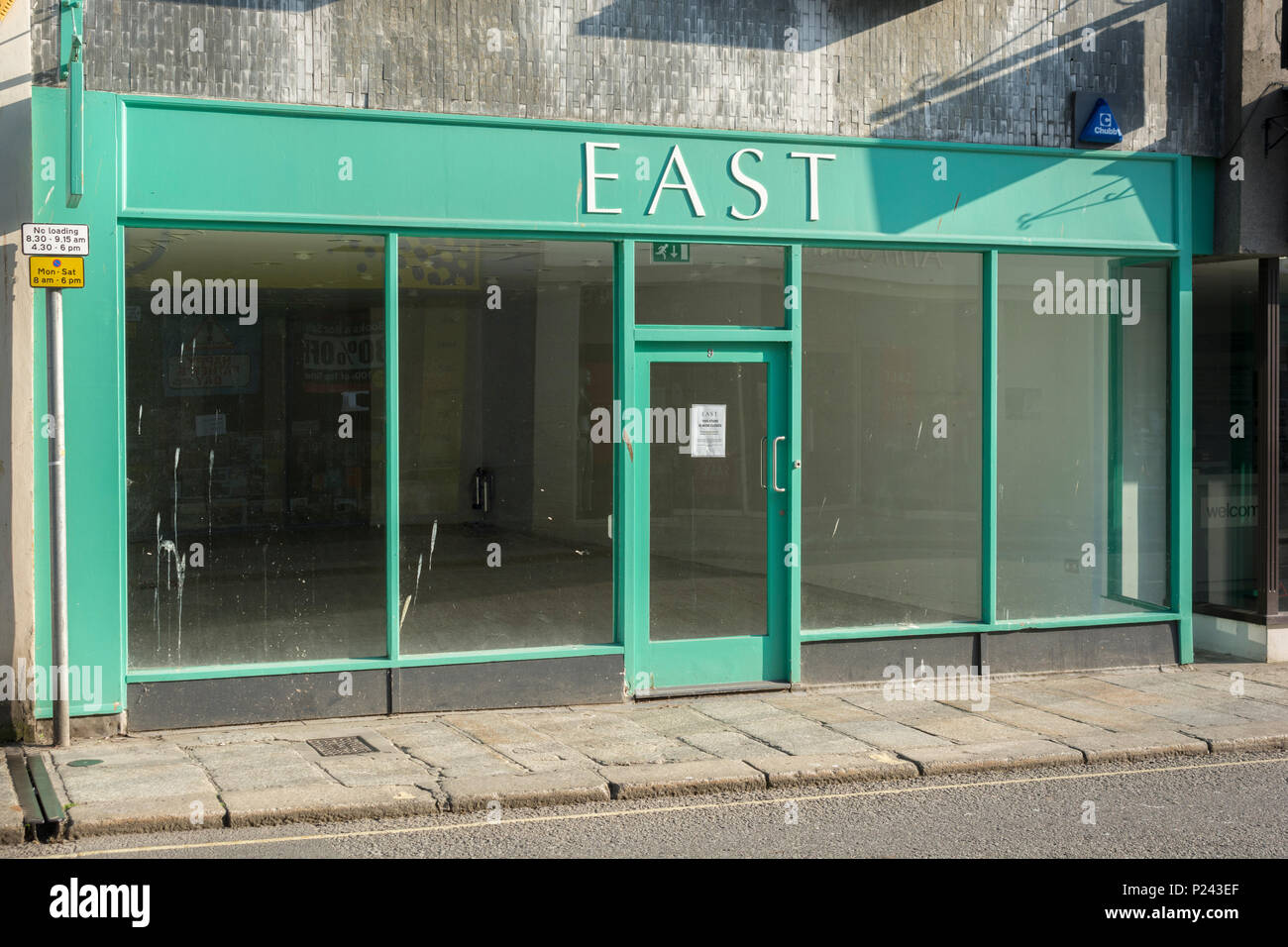 Empty vacant shop front in Truro, Cornwall. Metaphor for Death of the High Street, closed down shops, recession, high street closures, vacant shops. - Stock Image