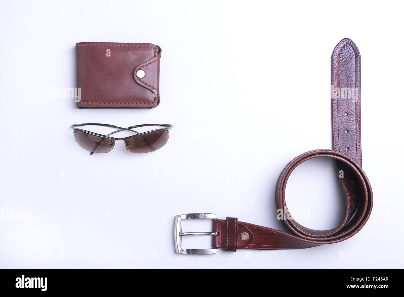 Men's accessories for business and rekreation. A professional studio photograph of men's business accessories. Top view composition - Stock Image