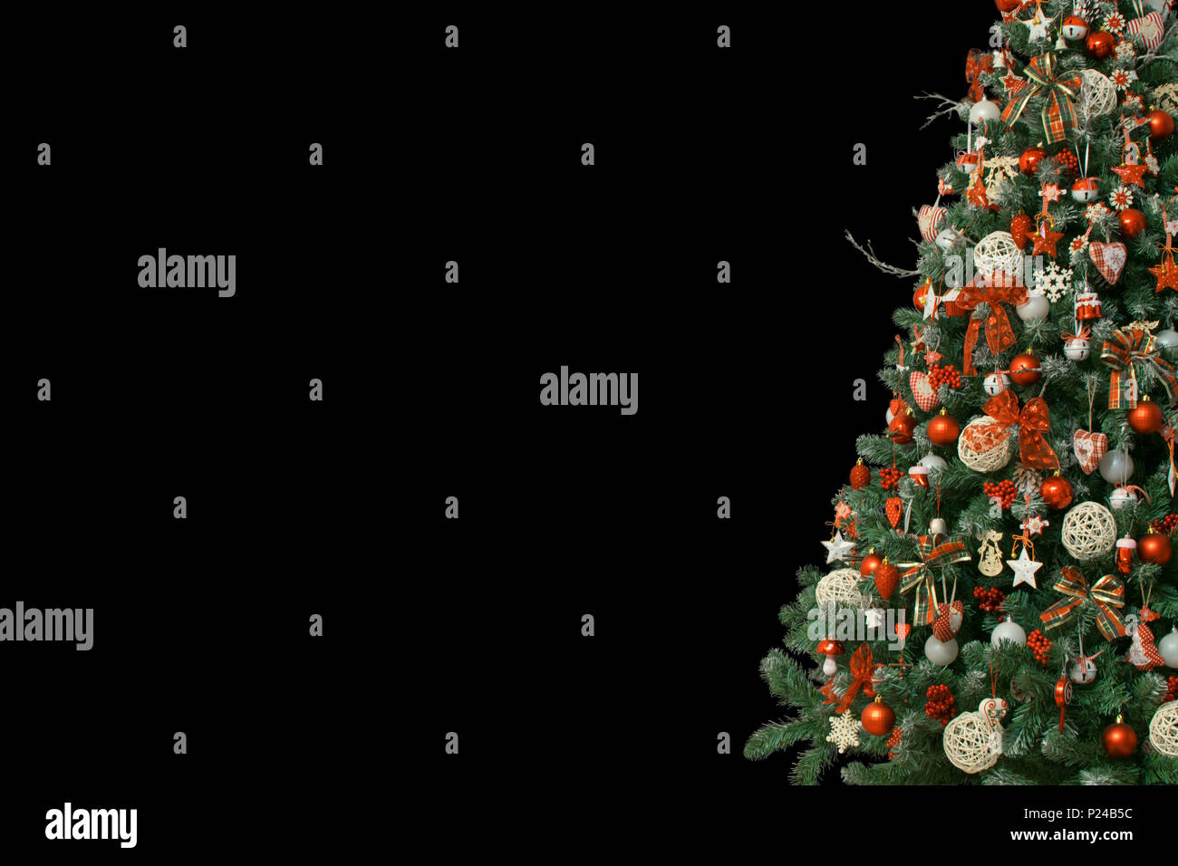 Detail Of Christmas Tree Isolated On Black Background Decorated With Vintage Ornaments Ratan Balls Burlap And Tartan Ribbons Red Balls Stock Photo Alamy