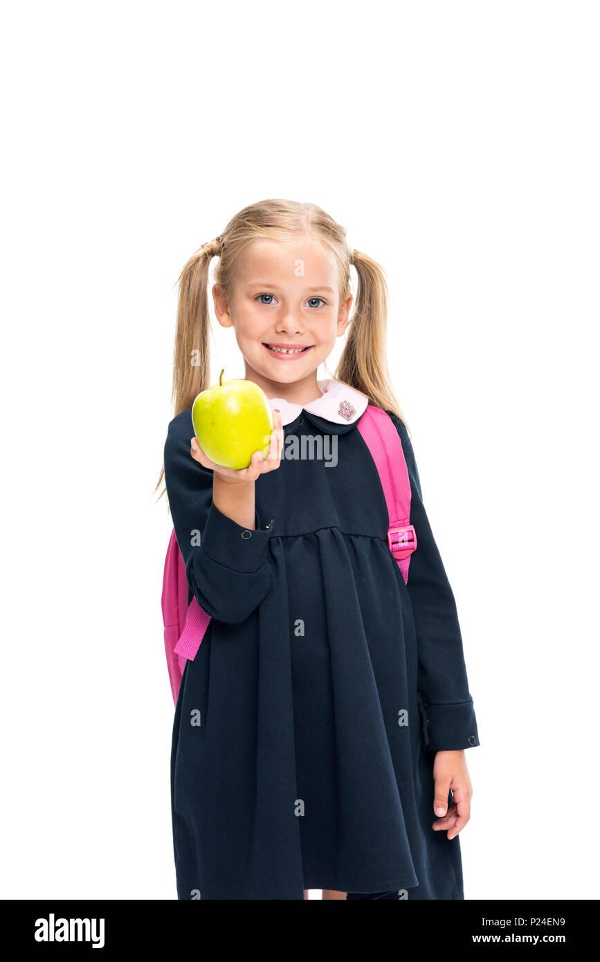 d87066cd9387 beautiful schoolgirl holding apple isolated on white Stock Photo ...