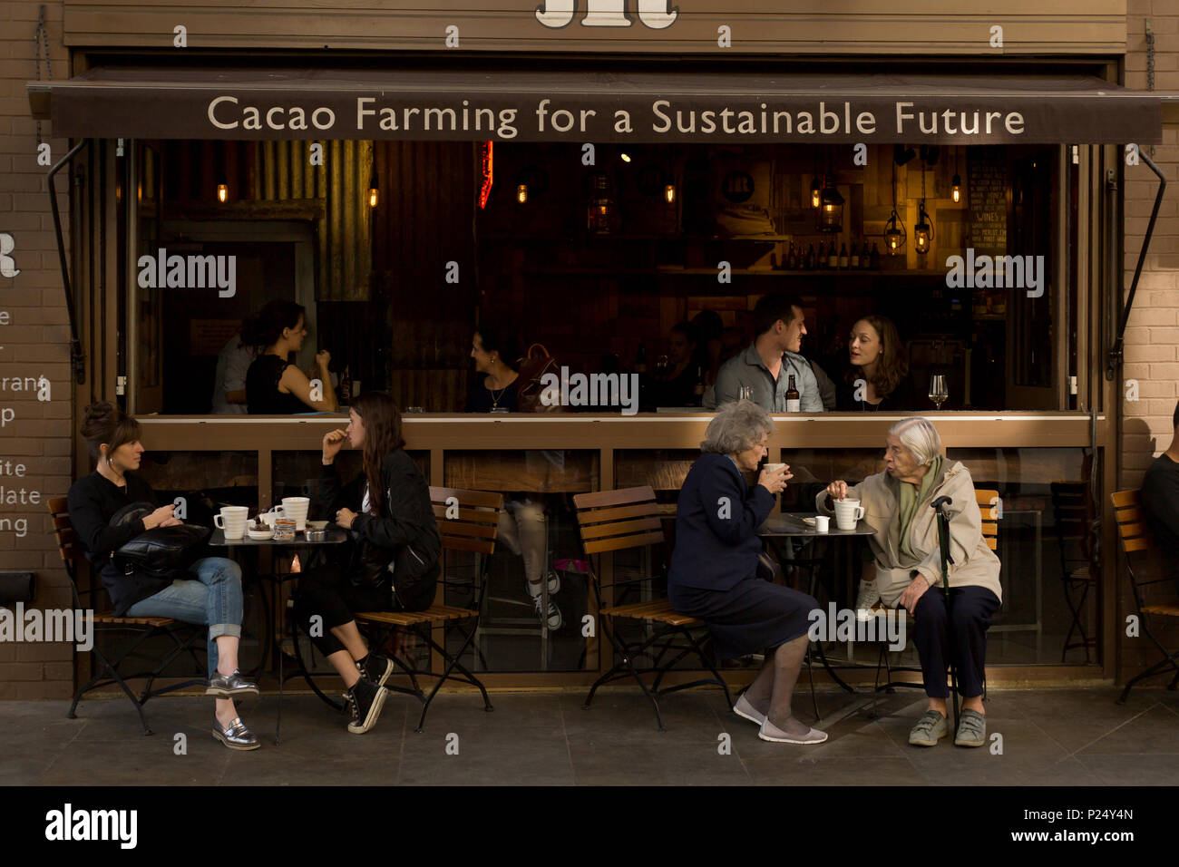 London, UK, guests in a street cafe - Stock Image
