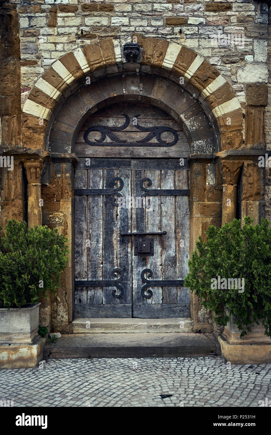 Portal Of A Church With Round Arch And Heavy Door Made Of Oak, Old