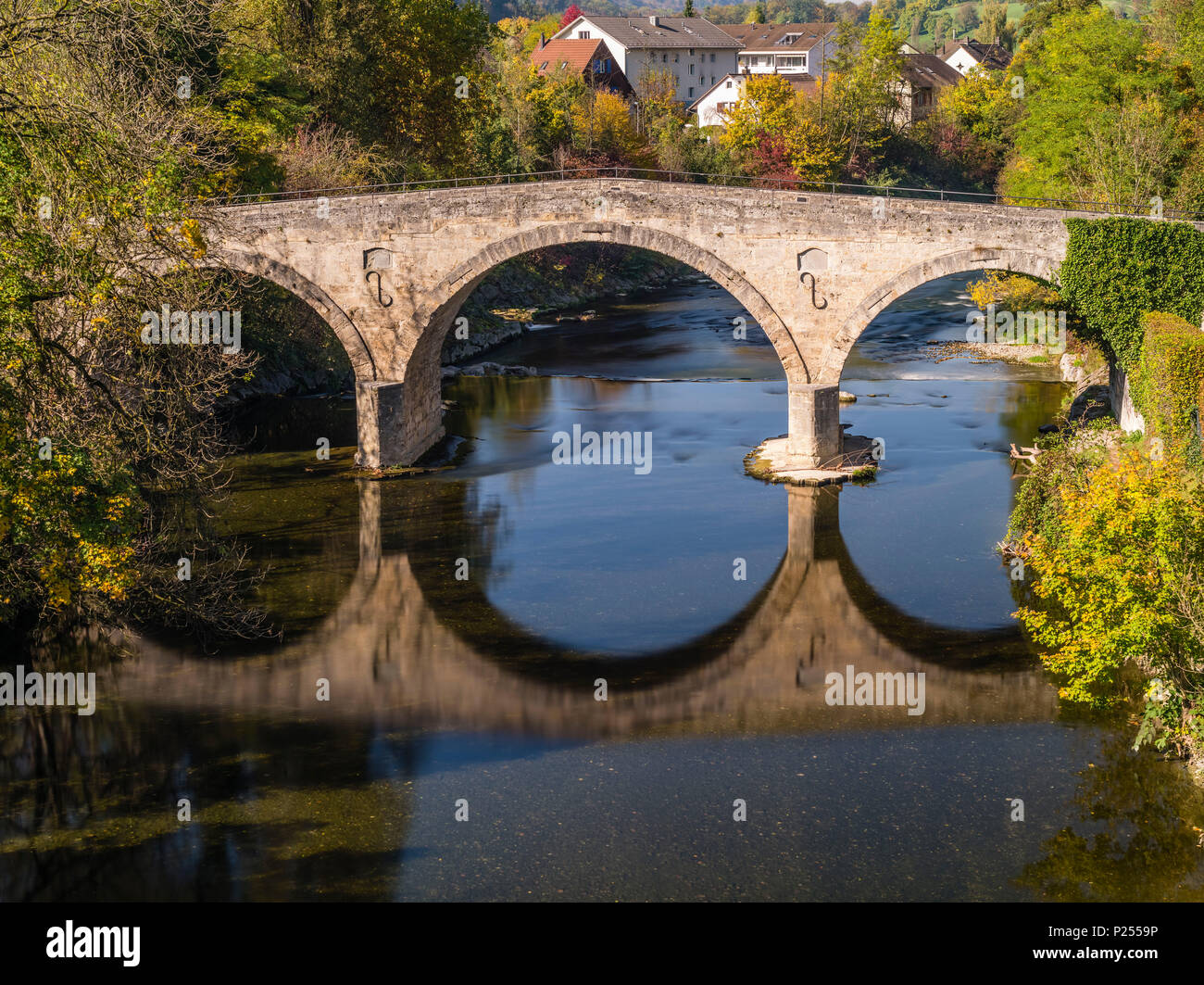 Historic Roman bridge across Töss River at Rorbas in the Canton of Zurich - Stock Image