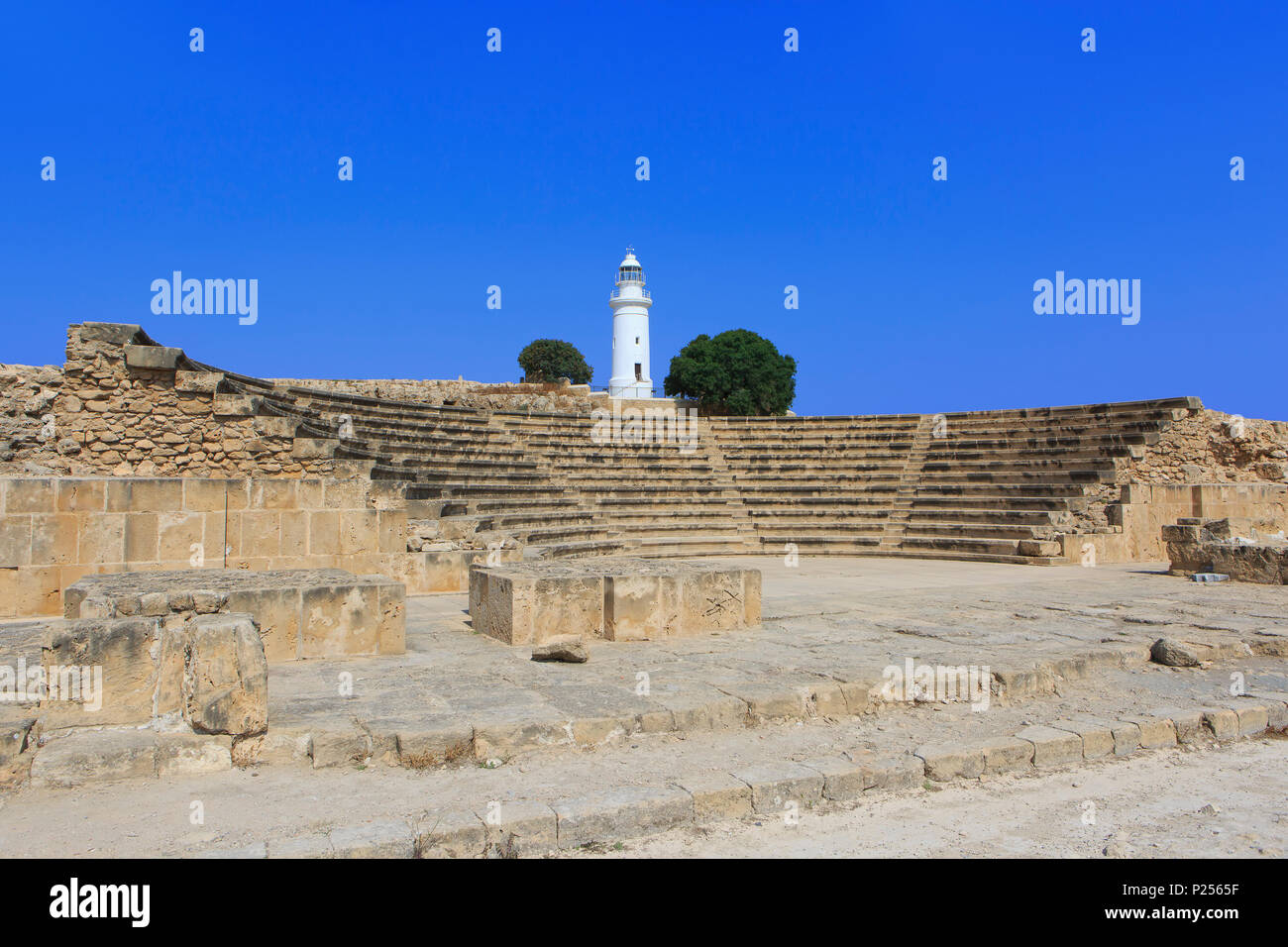 Odeon theater (2nd Century AD - 1200 seats) and lighthouse at the Paphos Archaeological Park in Paphos, Cyprus Stock Photo
