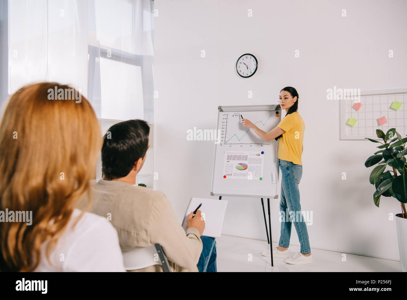 business people in casual clothing having business training in office - Stock Image