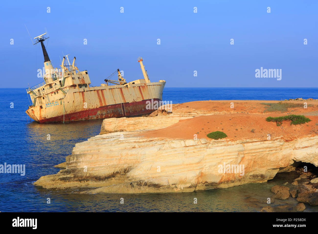 The M/V Edro III shipwreck resting off the rocks near the Sea Caves just outside Pegeia, Cyprus since 2011 - Stock Image