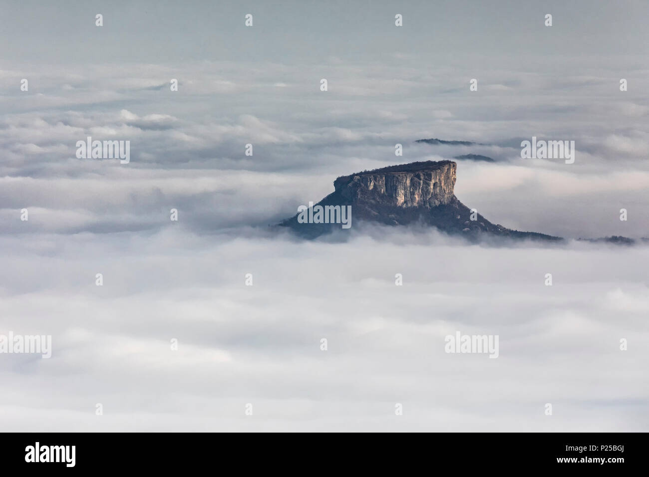 the bismantova stone emerges from the fog, Reggio Emilia province, Emilia Romagna district, Italy, Europe - Stock Image