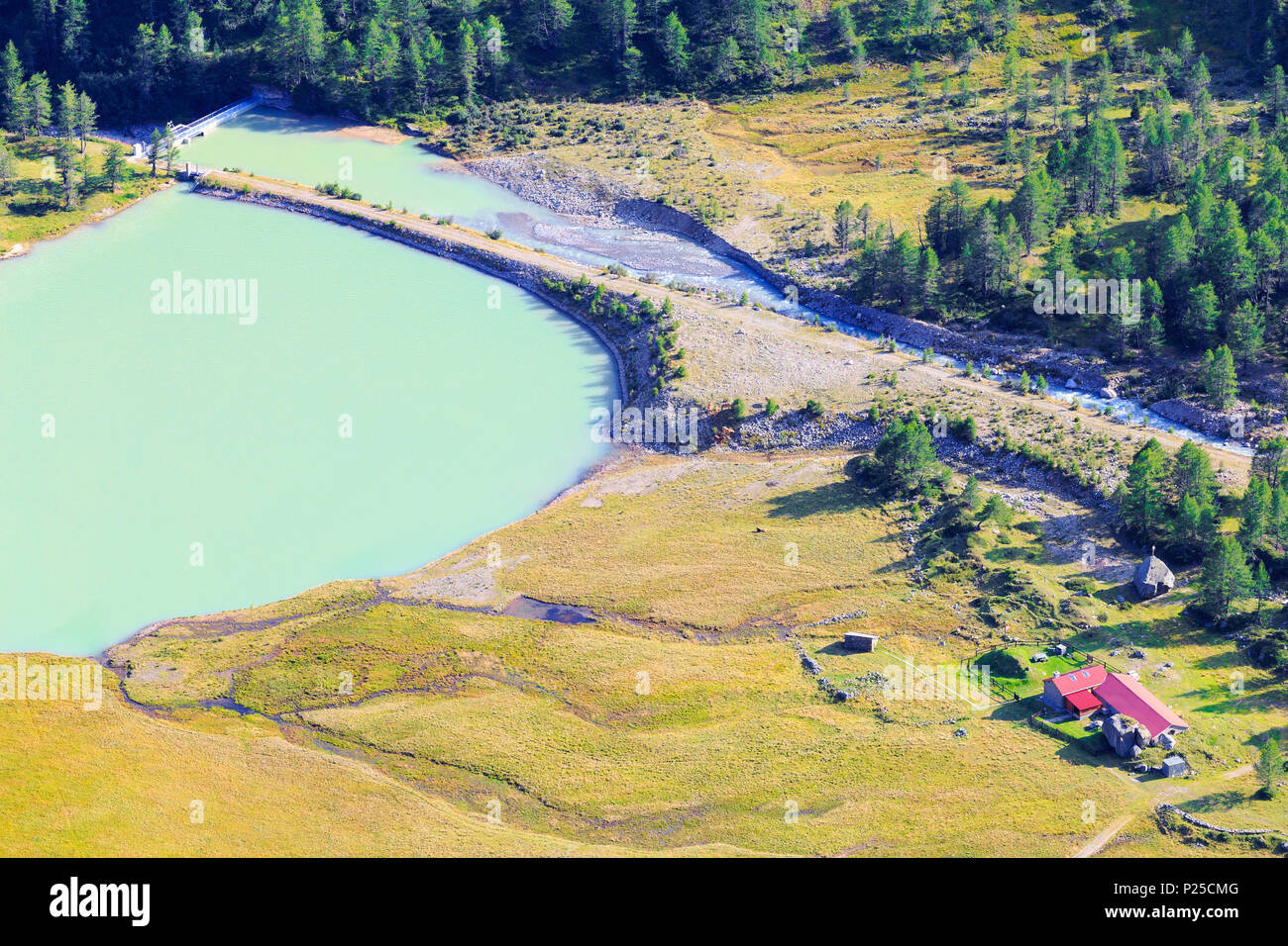 Farm and dam of Alp Palü from above, Alp Palü, Val Poschiavo, Graubünden, Switzerland. - Stock Image