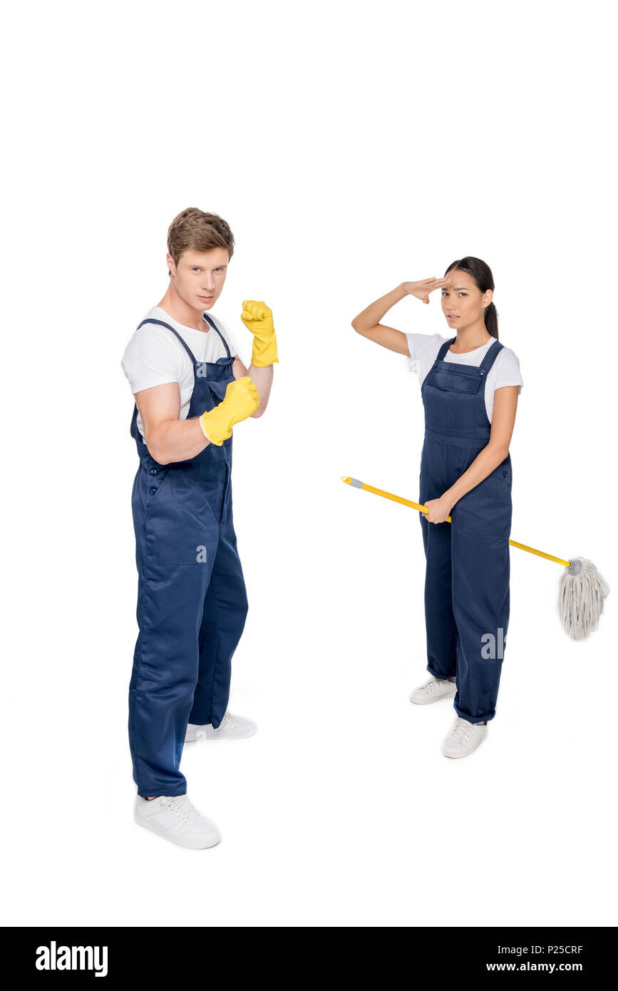 multicultural cleaners in uniform with mop isolated on white - Stock Image