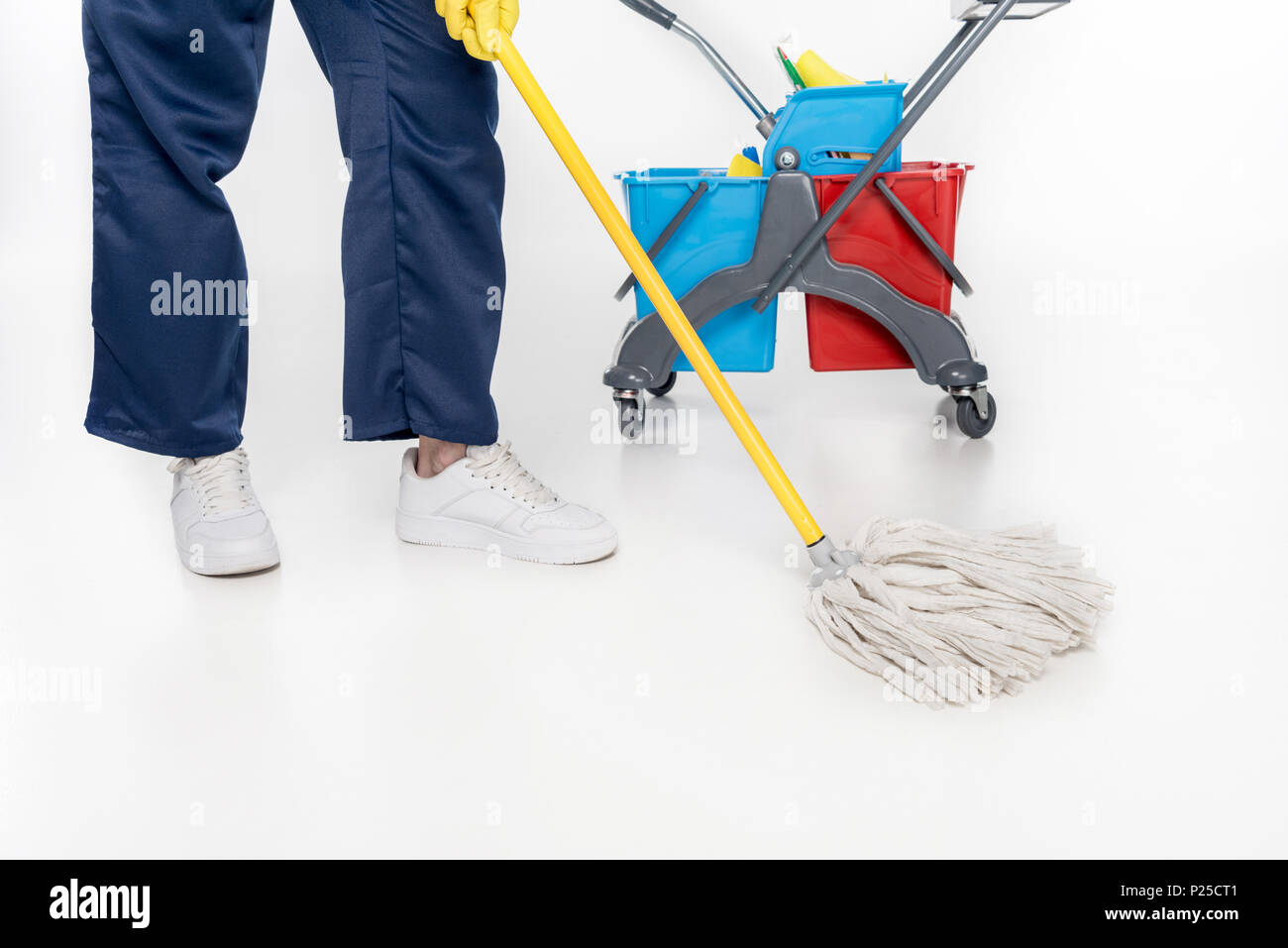 partial view of cleaner mopping floor with mop isolated on white - Stock Image