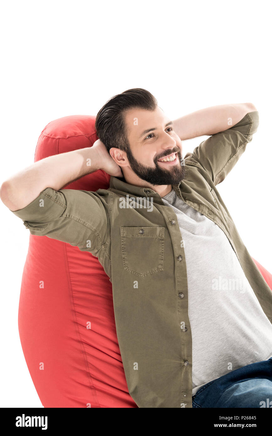 man relaxing on bean bag chair, isolated on white - Stock Image
