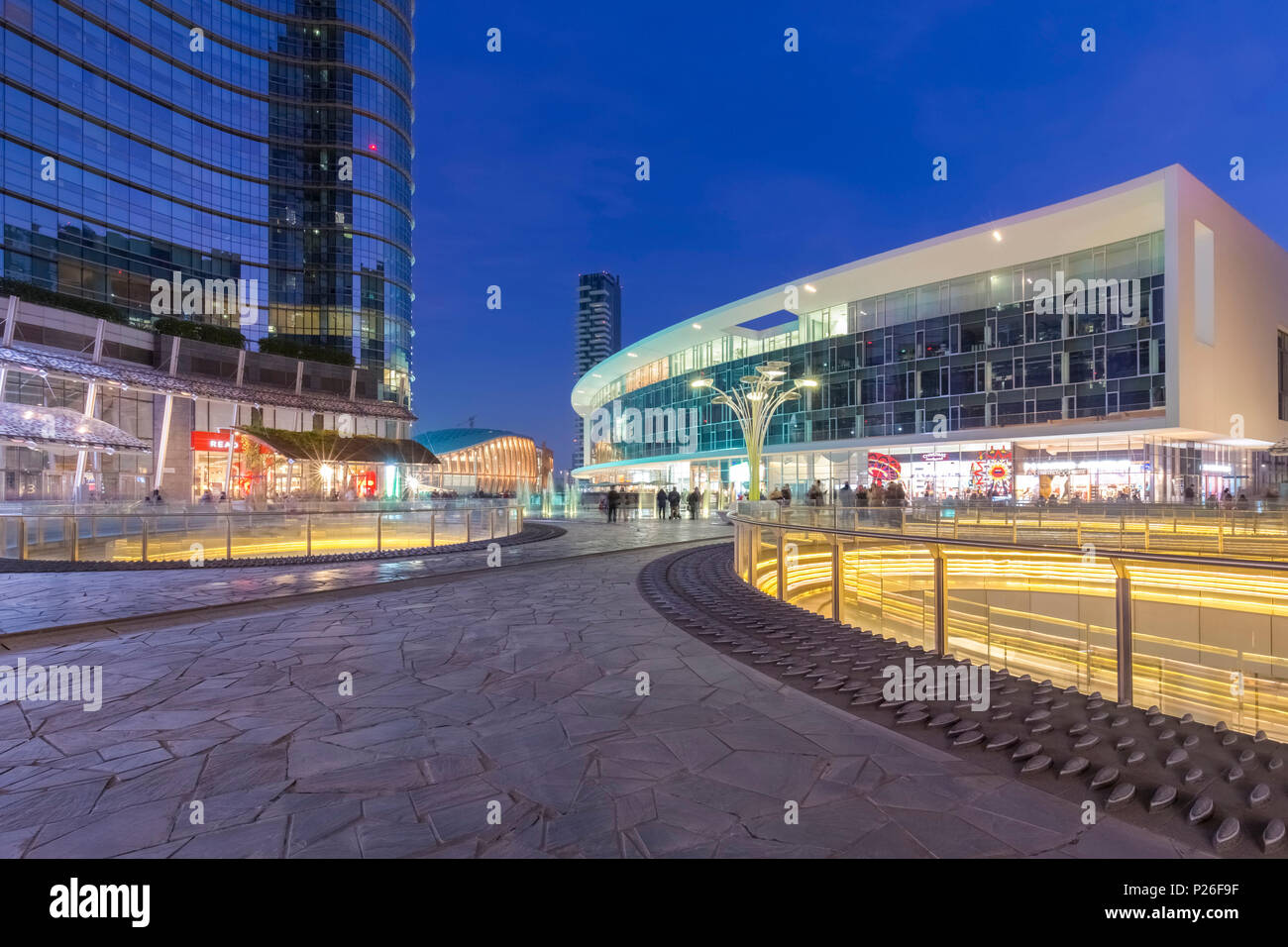 View of the Unicredit Tower, Unicredit Pavillion and Torre Solaria from Gae Aulenti square during the evening. Milan, Lombardy, Italy. Stock Photo