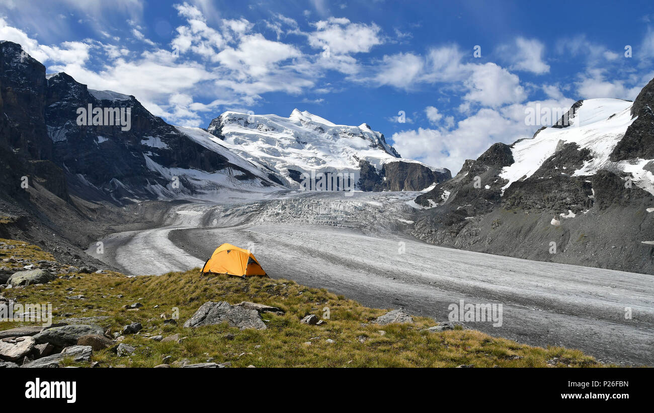 Camping on the ridge of moraine, close to the Grand Combin glacier, Grand Combin on background, Switzerland, Swiss - Stock Image