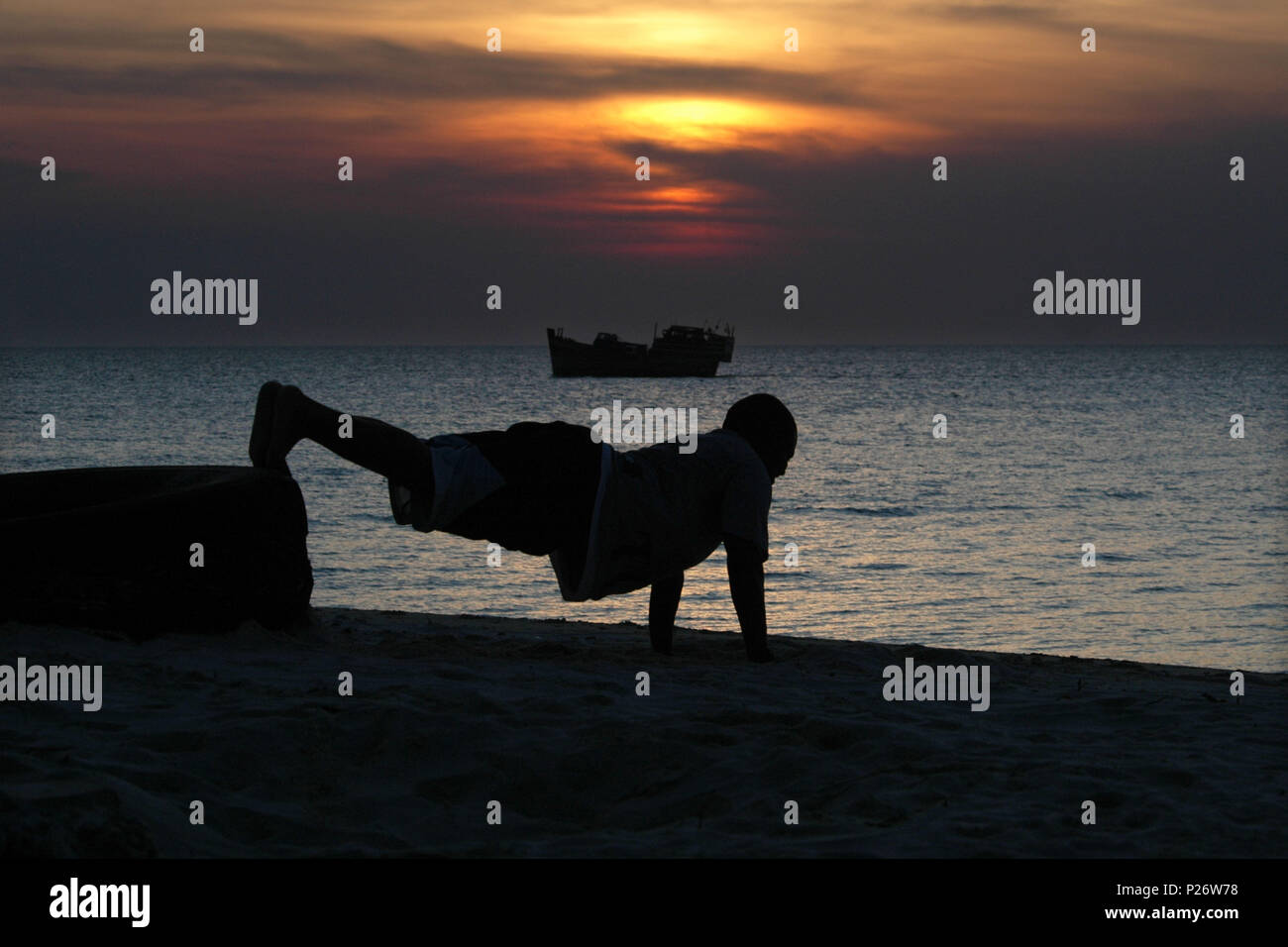 Keeping fit on the shore line in Zanzibar, Tanzania, Africa - Stock Image