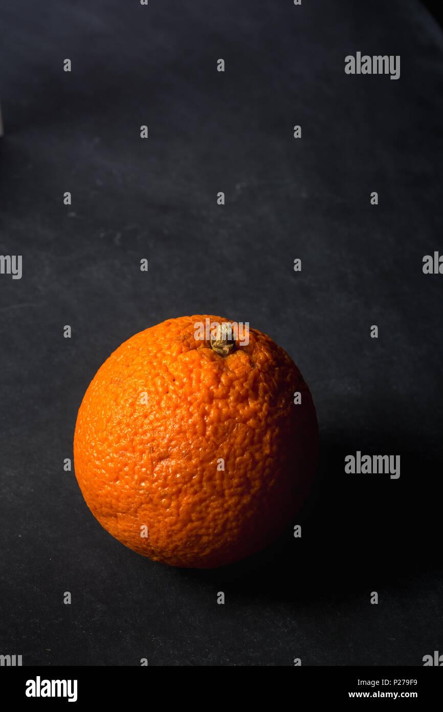 Orange on dirty chalkboard background Stock Photo
