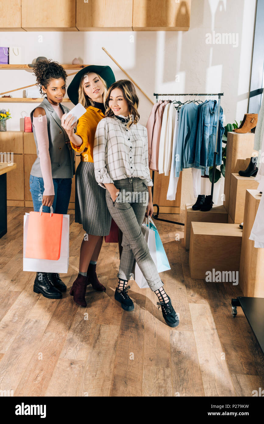 2444fd4dab29c group of stylish young women taking selfie in clothing store Stock ...