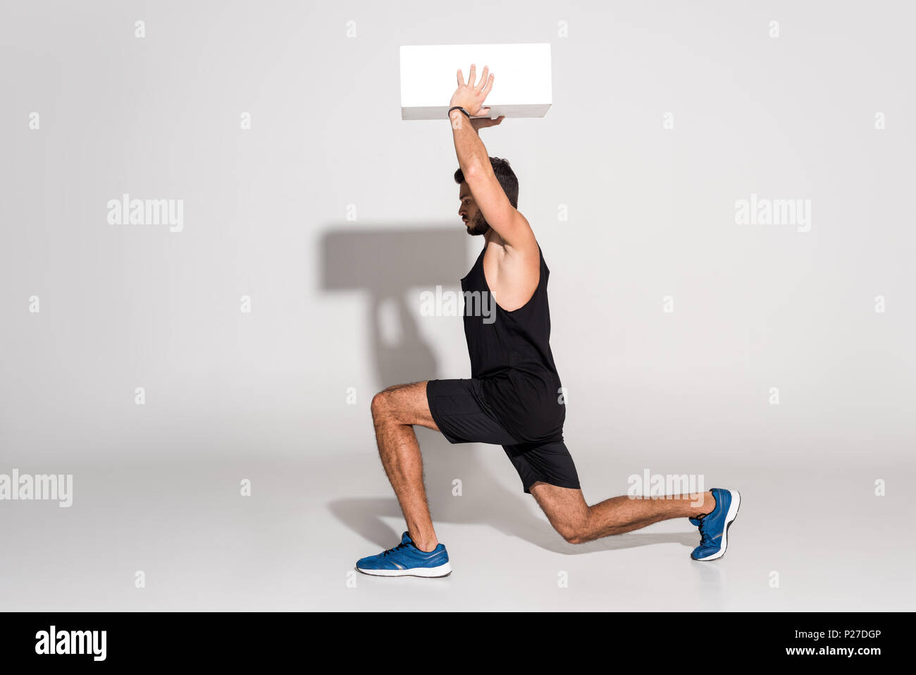 Man Doing Squats Stock Photos & Man Doing Squats Stock Images - Alamy