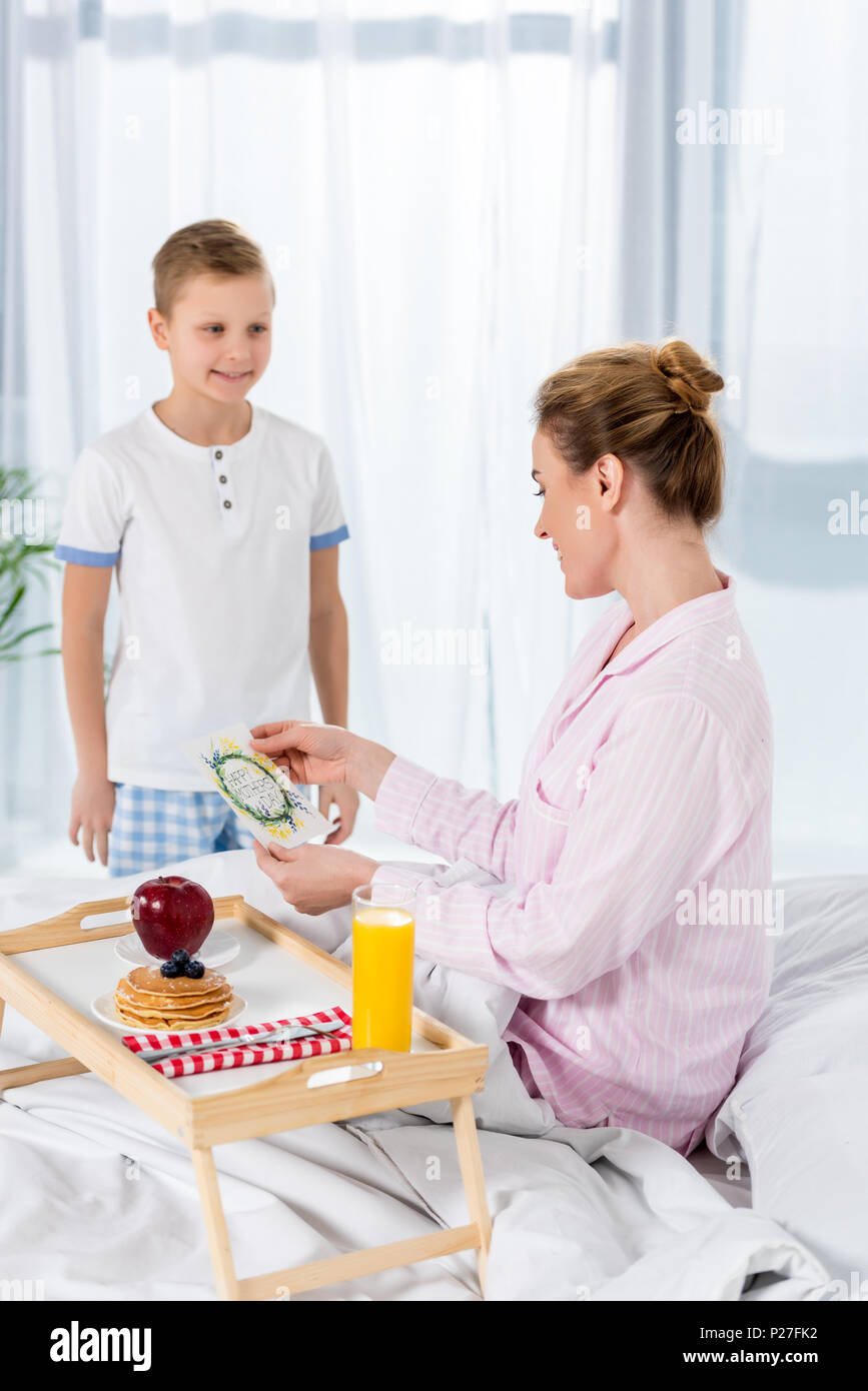Little Son Giving Breakfast In Bed For Mother On Mothers Day Stock Photo Alamy