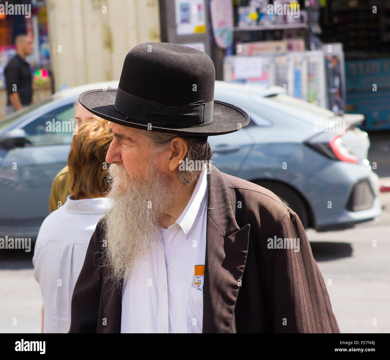 9 May 2018 A aged Hasidic Jew with a long white beard in traditional clothing on foot in a busy street in Jerusalem Israel - Stock Image