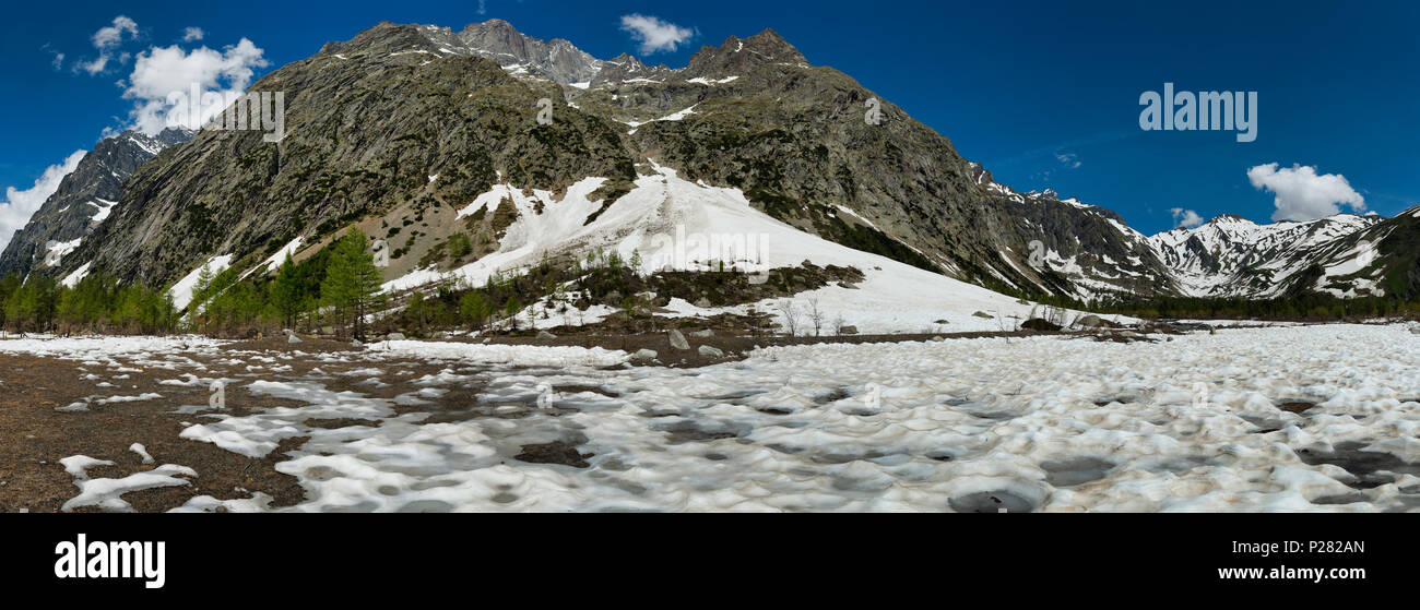 Aosta valley landscape in spring season during the melting snow in Val Ferret, beautiful day with blue sky - Stock Image
