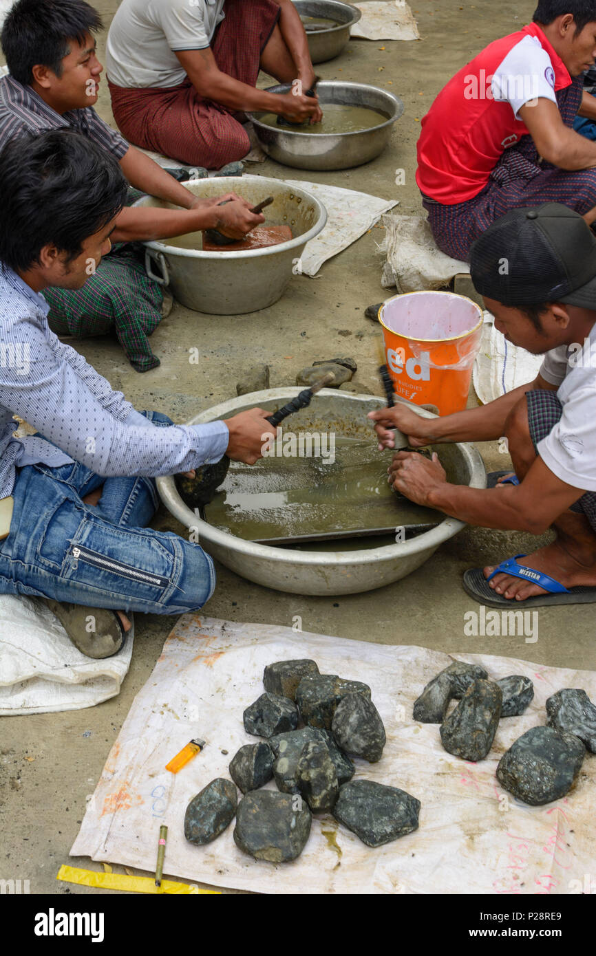 Mandalay, Jade Market, men cleaning stones, Mandalay Region, Myanmar (Burma) Stock Photo