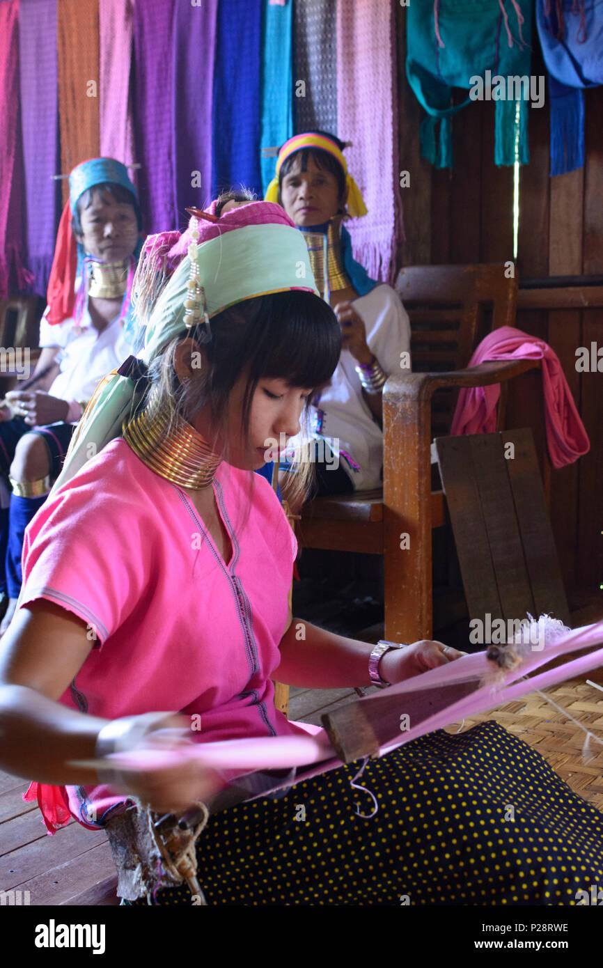 Ywama, Kayan Lahwi (Padaung) Long Neck girl woman weaving, weaver loom, Inle Lake, Shan State, Myanmar (Burma) Stock Photo