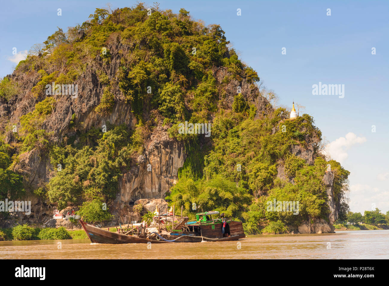 Hpa-An, hill of bat cave, Thanlwin (Salween) River. River dredge boat operating on Thanlwin (Salween) River. These are often used for gold sluicing or gravel mining., Kayin (Karen) State, Myanmar (Burma) - Stock Image
