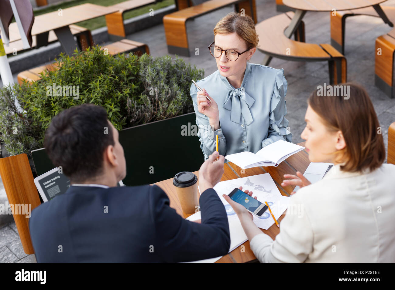 Three chief executives discussing future promotions - Stock Image