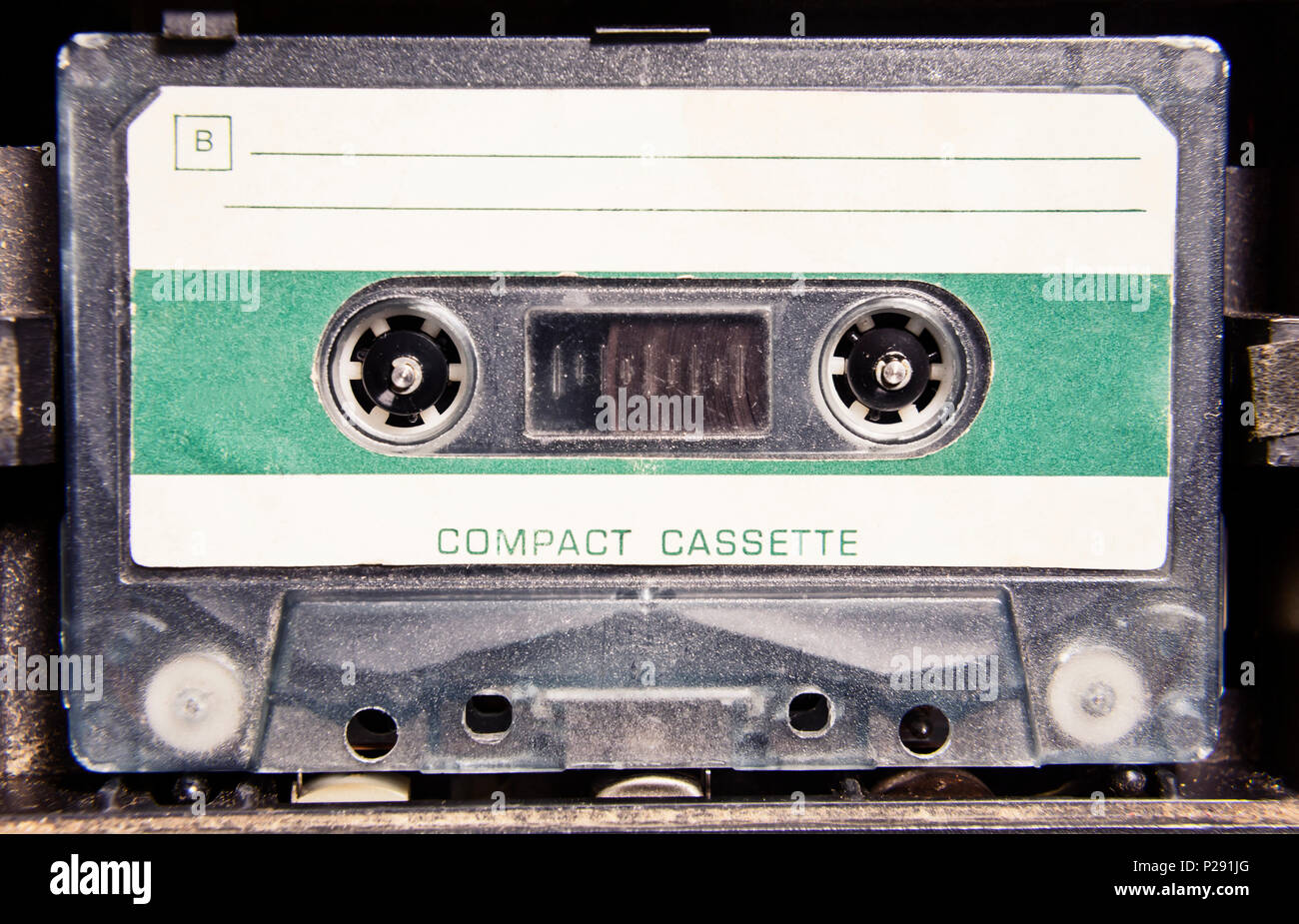 An old cassette tape in a player, with enough room to add your own text elements. - Stock Image