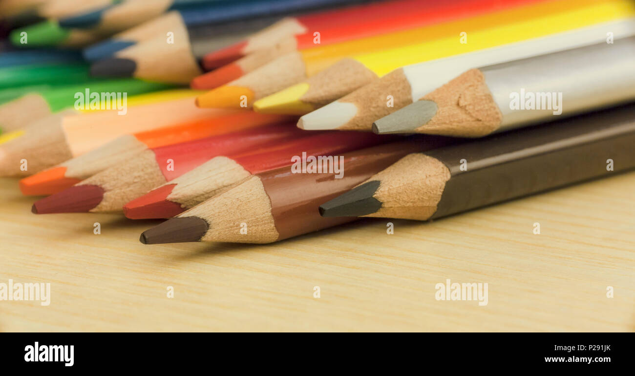 A set of colored pencils over a table. Side view. Concept: back to school. - Stock Image