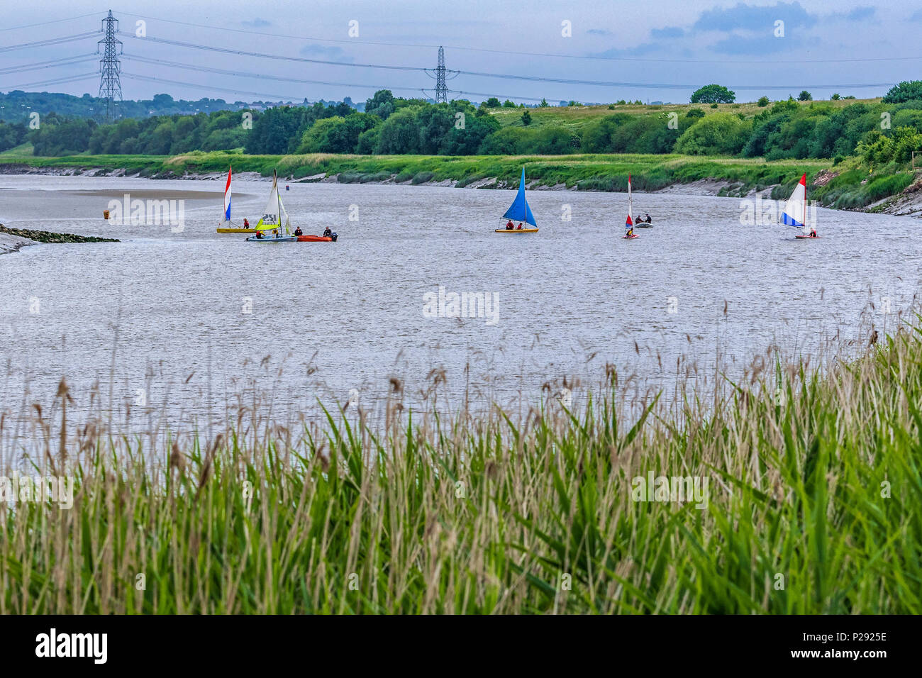 Dinghy sailing on the river Mersey at Fiddlers Ferry, Penketh. - Stock Image