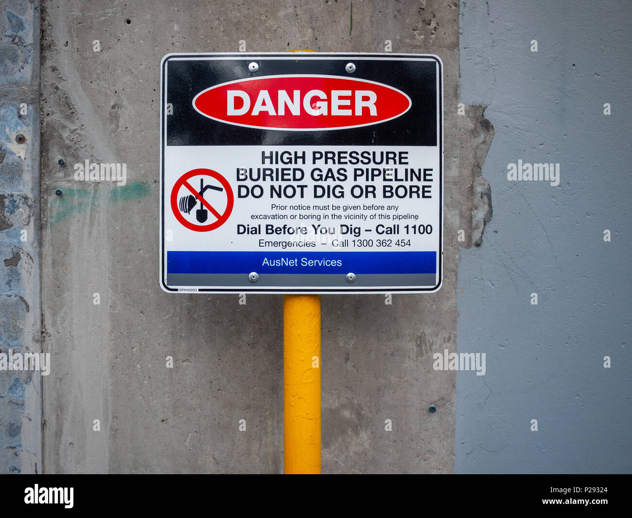 Warning sign of high pressure buried gas pipeline. - Stock Image