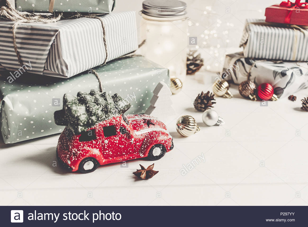 modern christmas ornaments and car toy with tree presents cones anise on white wooden background merry christmas concept seasonal greetings happy - Modern Christmas Ornaments