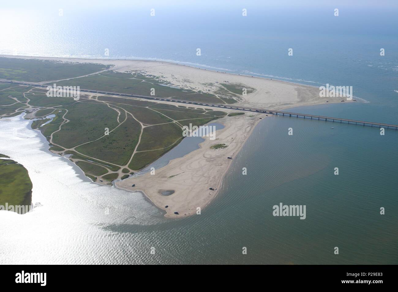 Aerial view of the Texas Gulf Coast, Galveston Island,USA. Haze due to warm weather conditions. View of San Luis Beach, San Luis Pass and Pointe West. Stock Photo