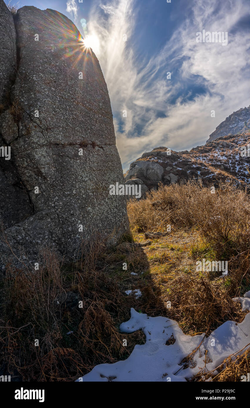 Rock and sunstar - Stock Image