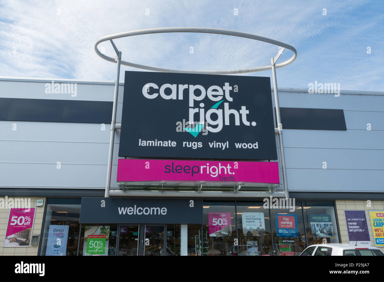 Exterior of carpet right shop with sign, UK - Stock Image