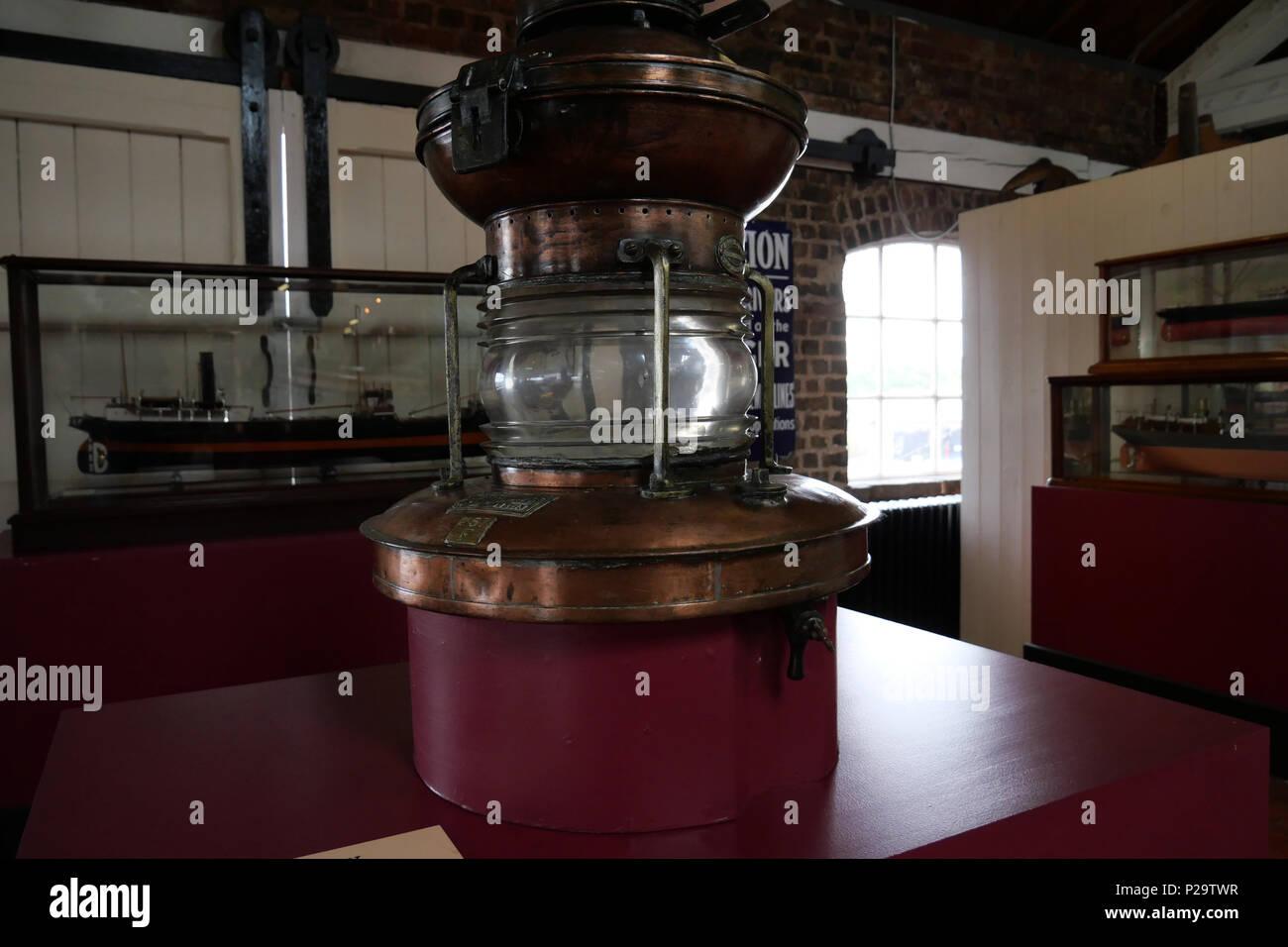 Navigation Lamp with Oil Burner. National Waterways Museum. UK. - Stock Image