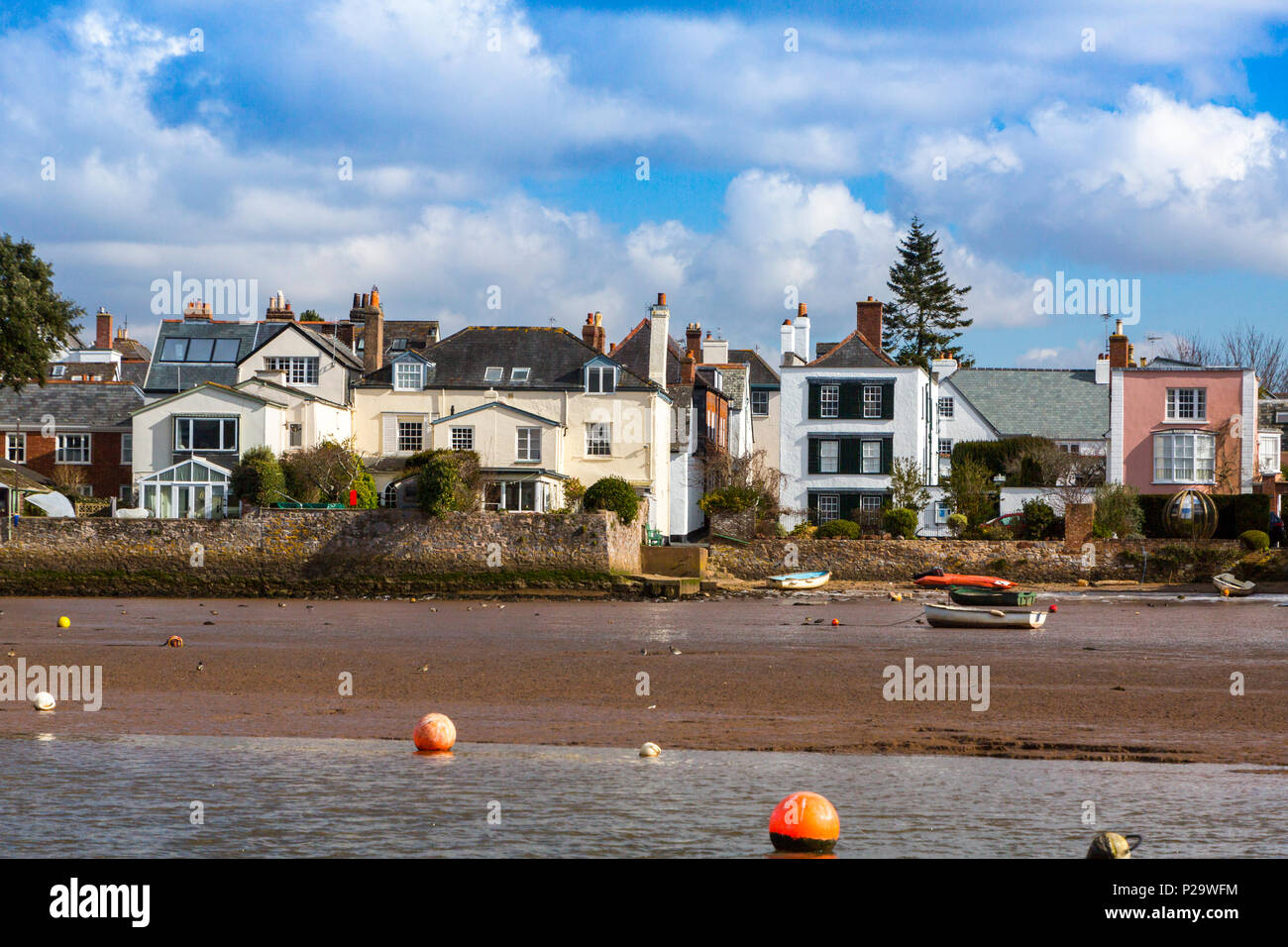 Waterfront properties above the mudflats of the River Exe at Topsham, Devon, England, UK - Stock Image