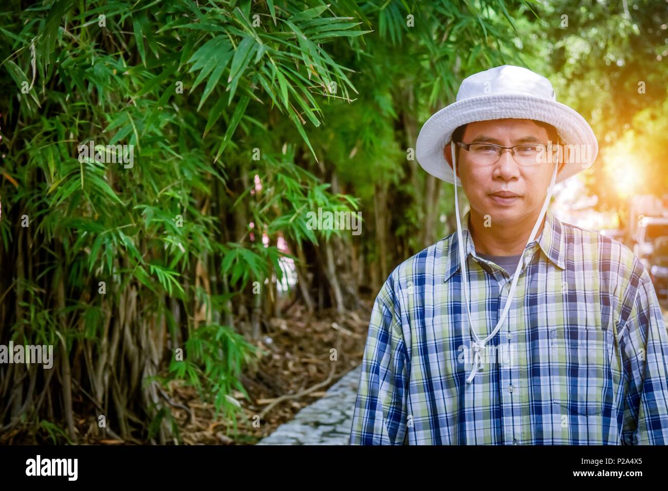 40-55 year old male farmer succeeded. Bamboo growing career. A career that can be hugely harsh income. By using the Smart Farm business model. - Stock Image
